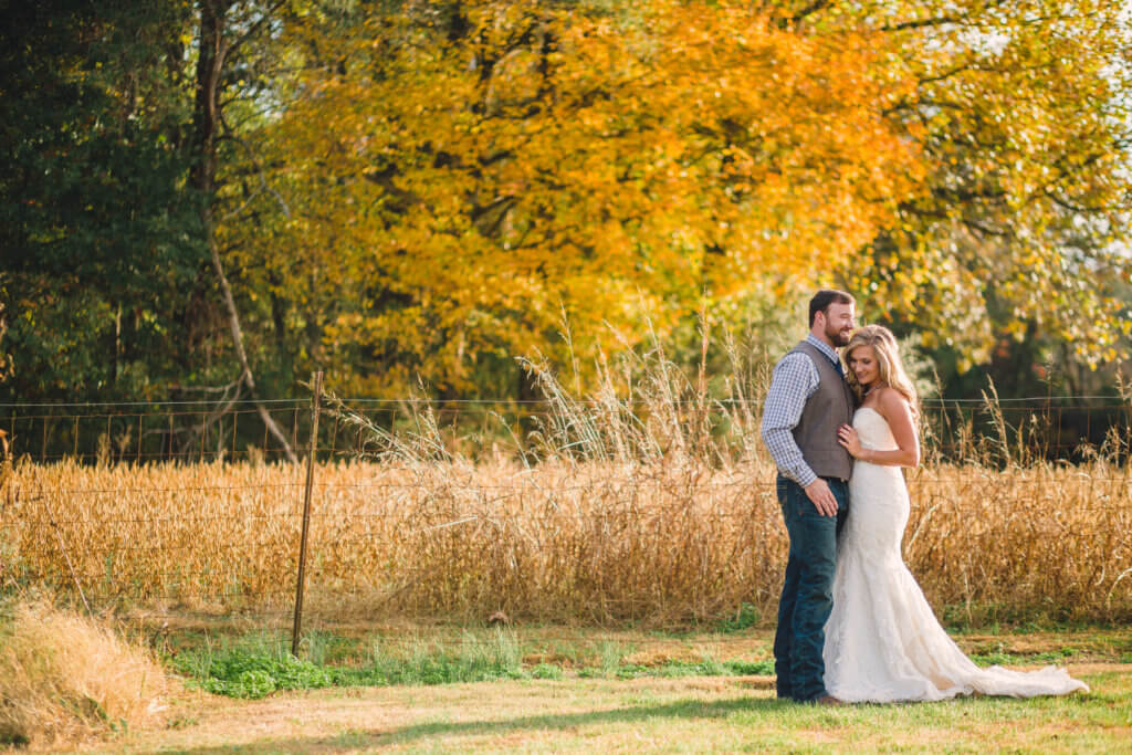 bride and groom on farm in Knoxville Tennessee