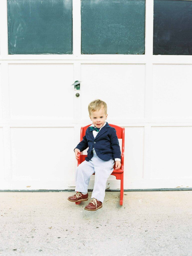 Boy in red chair in historic Knoxville neighborhood