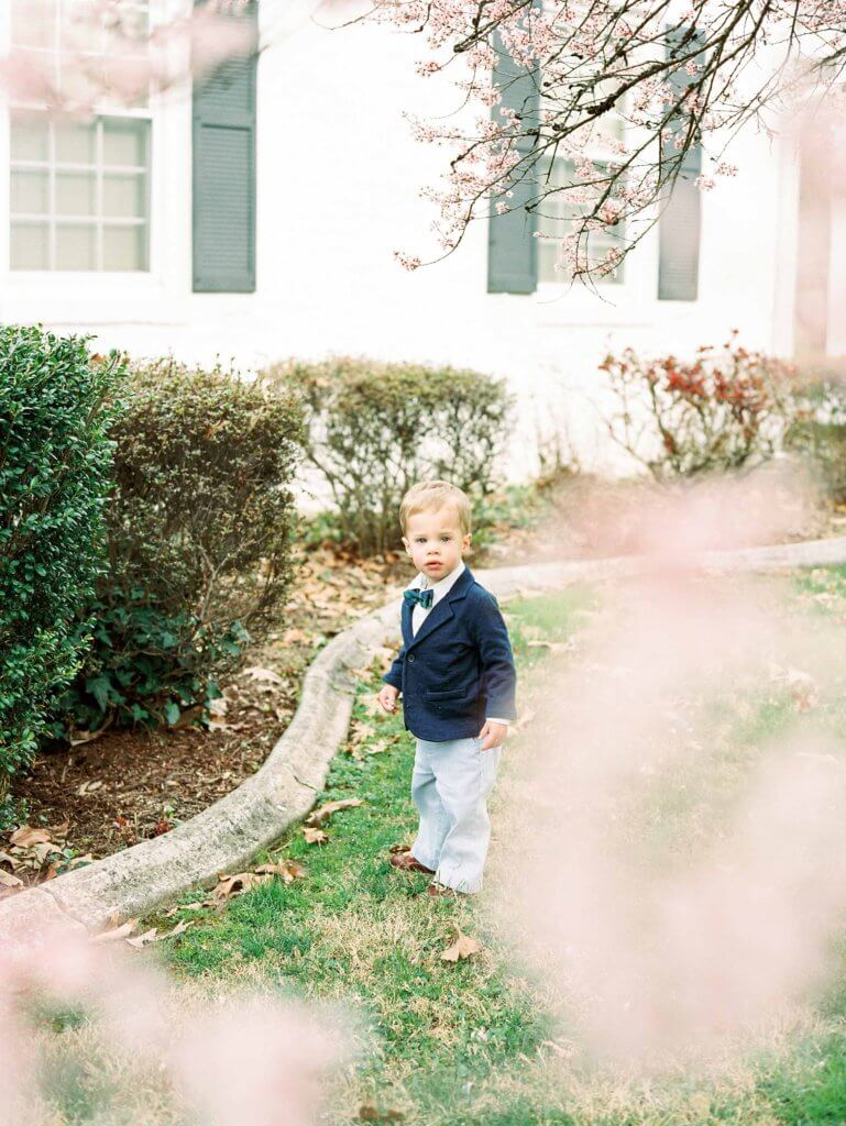 Boy in yard having Easter Portraits taken