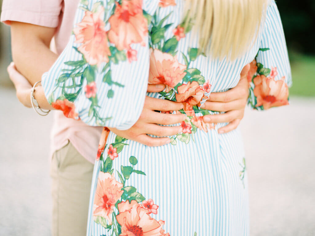 Bride and Groom showing Outfits for Engagement Photos