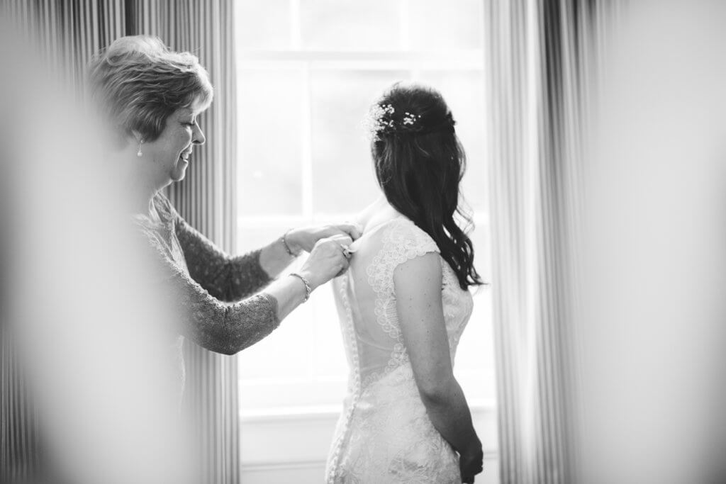 Bride getting dressed at Starmount Presbyterian Church Greensboro NC