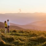 man and woman engaged on Max Patch Bald Mountain near Asheville NC